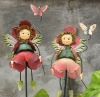 Artificial rose flower fairy on garden stick