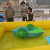 funny blue and green plastic paddle boat